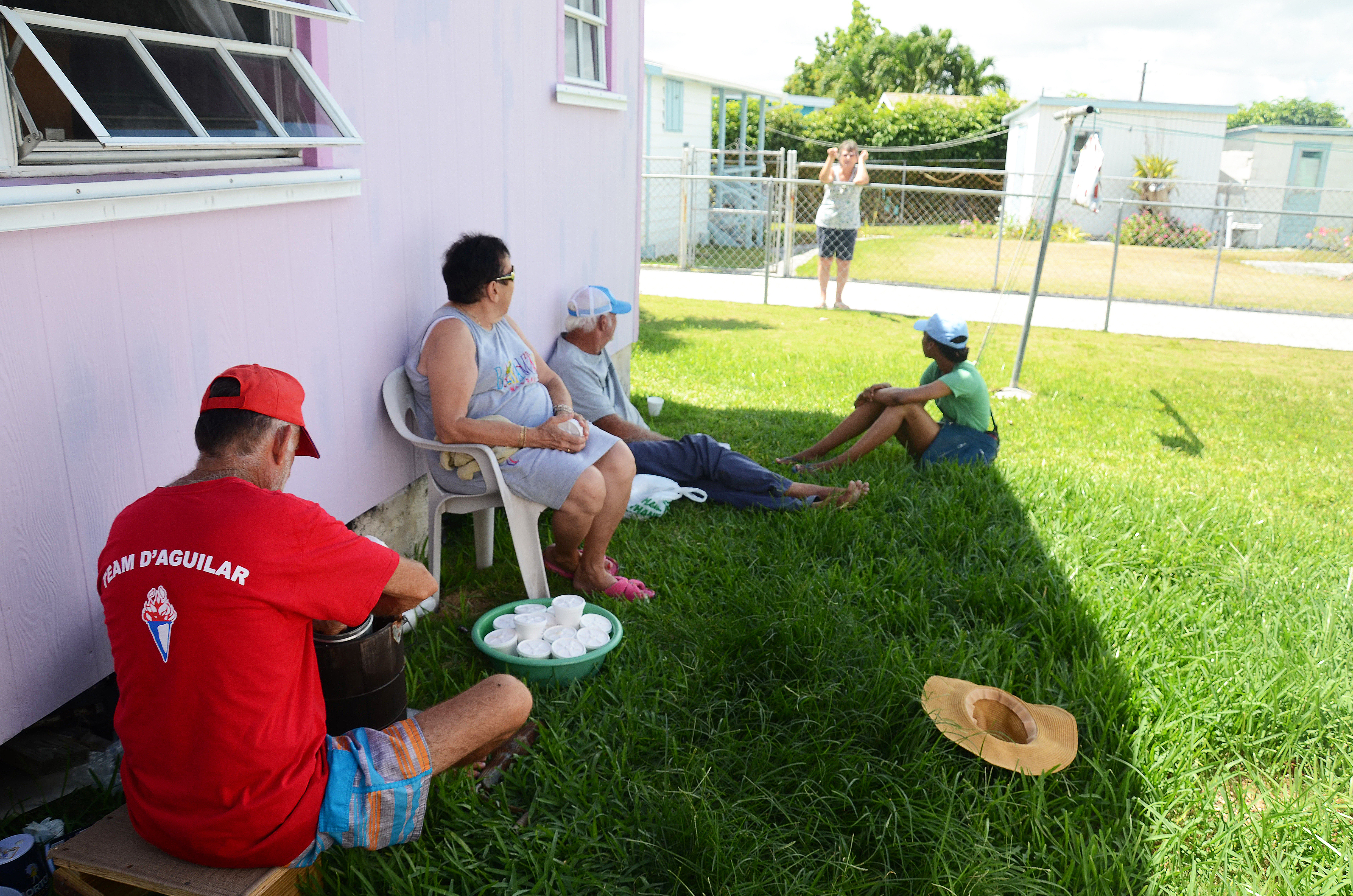 Pinders, neighbours and Kelly on the grass, Cherokee Sound Abaco