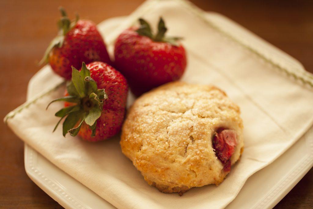 Closeup of strawberry cream scone
