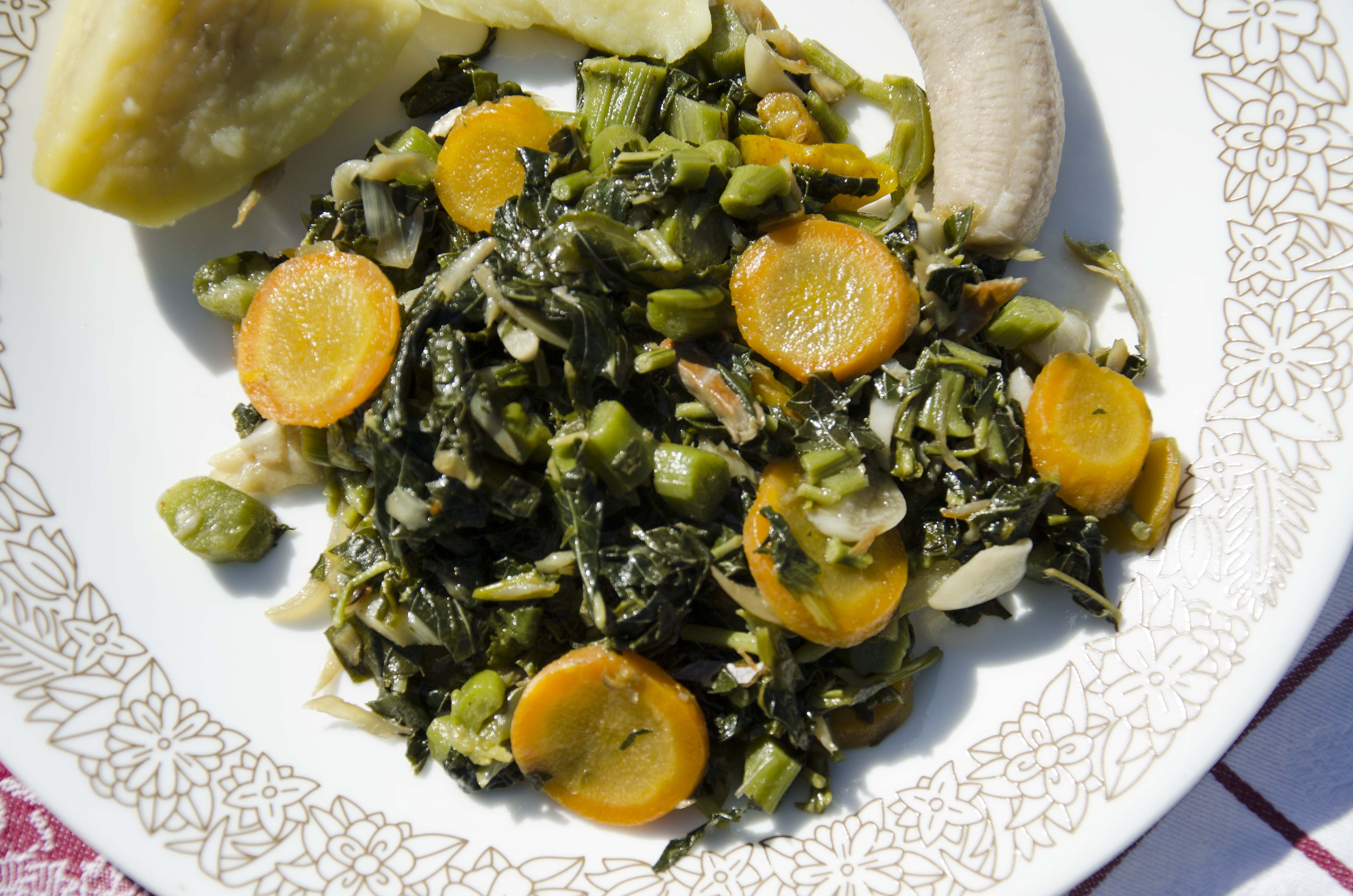 Steamed callaloo and boiled food close up.
